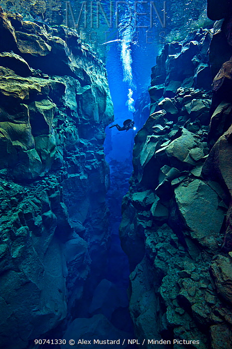 Diver explores the cathedral at Silfra Canyon, deep fault filled with fresh water in the rift valley between the Eurasian and American tectonic plates, at Thingvellir National Park, Iceland. May 2011. In this photo the American plate is on the right and the Eurasian plate on the left. No release available.