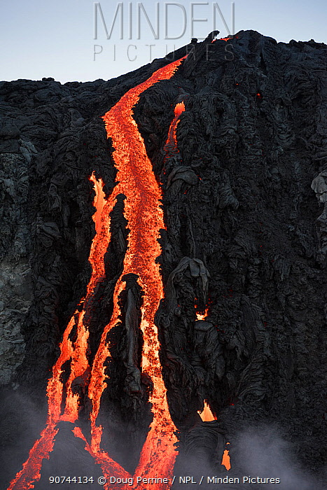 Hot lava from the 61G flow, emanating from Pu'u O'o on Kilauea Volcano, flows over seacliffs into the ocean on the first week of its ocean entry at Kamokuna, in Hawaii Volcanoes National Park, Kalapana, Puna, Hawaii, USA, July 2016