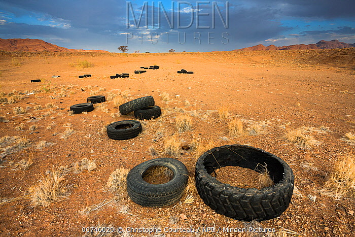 Pollution in the Namib Desert, due to illegal dumping of old tires. Namibia.