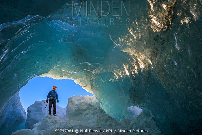 Man exploring ice cave, Vatnajokull, Iceland, March 2016.