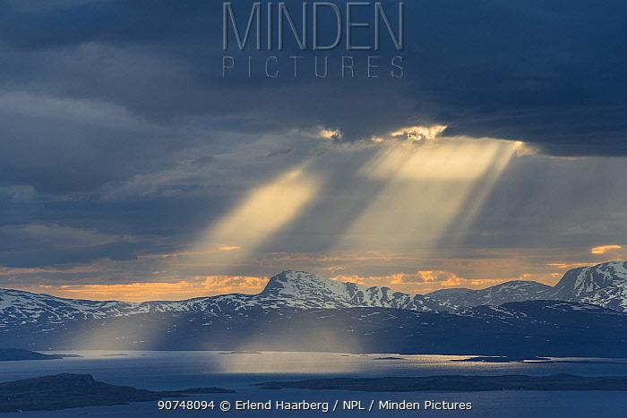 Sunbeams from dark clouds above Lake Virihaure in Padjelanta National Park, Laponia World Heritage Site, Swedish Lapland, Sweden.