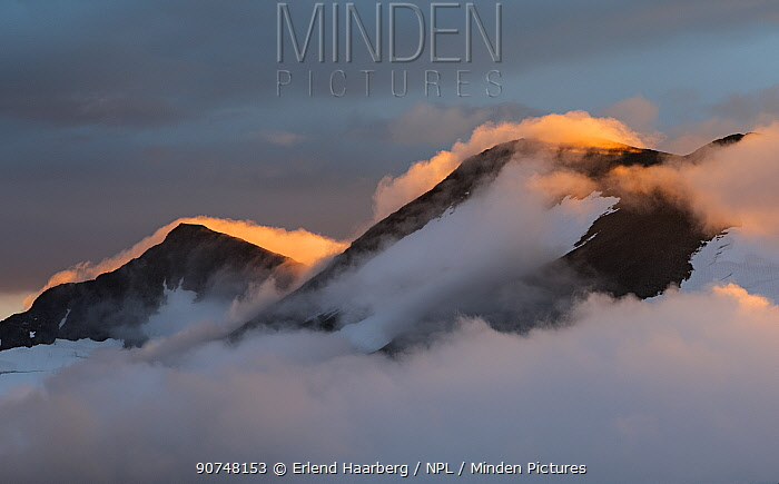 Colourful sunset clouds above Mount Ryggasberget (1946m), viewed from Mt Naite (1620m). Sarek National Park, World Heritage Laponia, Swedish Lapland, Sweden.