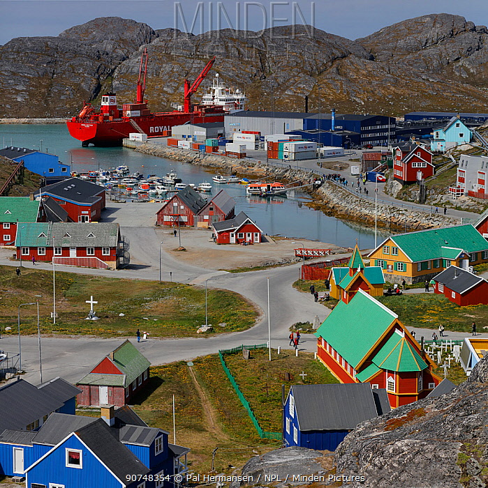 Paamiut town on coast of Greenland, with Royal Arctic Line boat moored, Greenland, July 2016.