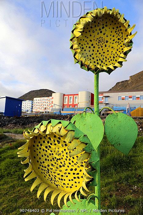 Metal sunflower decoration, Barentsburg, Svalbard, Norway, July.