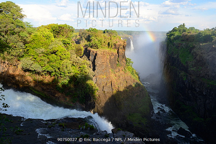 Victoria Falls with mist and rainbow, Zambezi River, Zimbabwe
