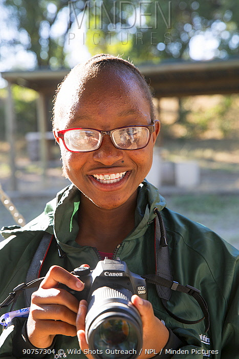 Pupil Lebogang Sekgwari with DSLR camera during residential photography course organised by Wild Shots Outreach. Kruger National Park, South Africa, June 2017.
