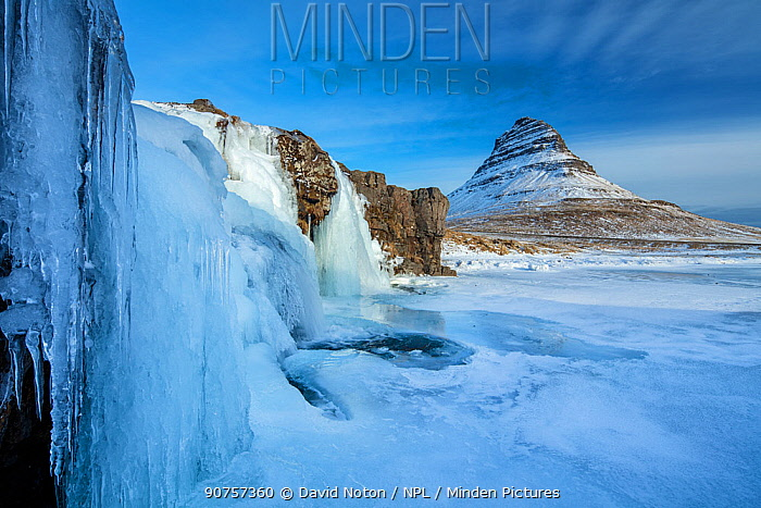 Snow covered Kirkjufell Mountain and frozen waterfalls,, Snaefellsness Peninsula, Iceland, March 2015.