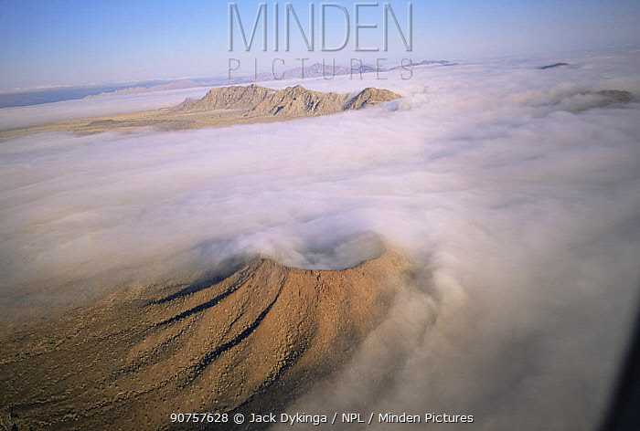 Aerial view of ground fog swirling round Crater Caravajales, Biosphere Reserve of Pinacate and Gran Desierto Altar, Sonora, Mexico