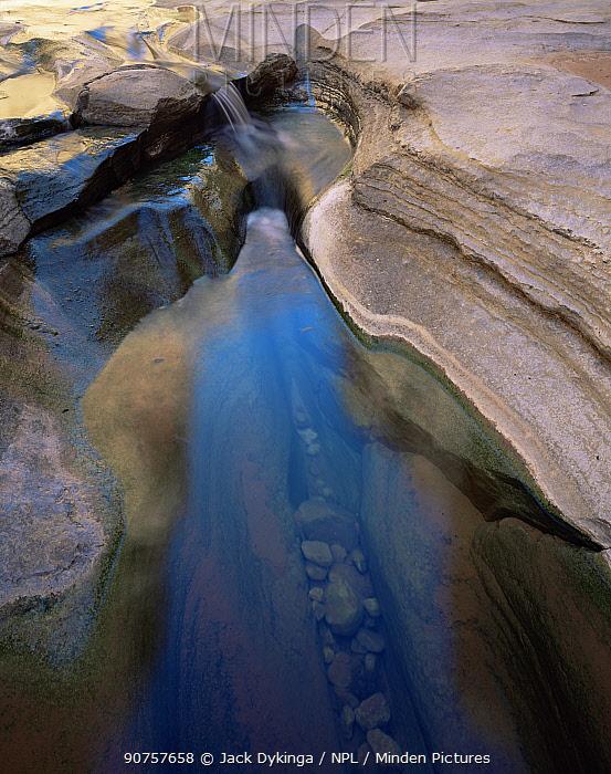 Water running down National Canyon, Grand Canyon NP, Arizona, USA