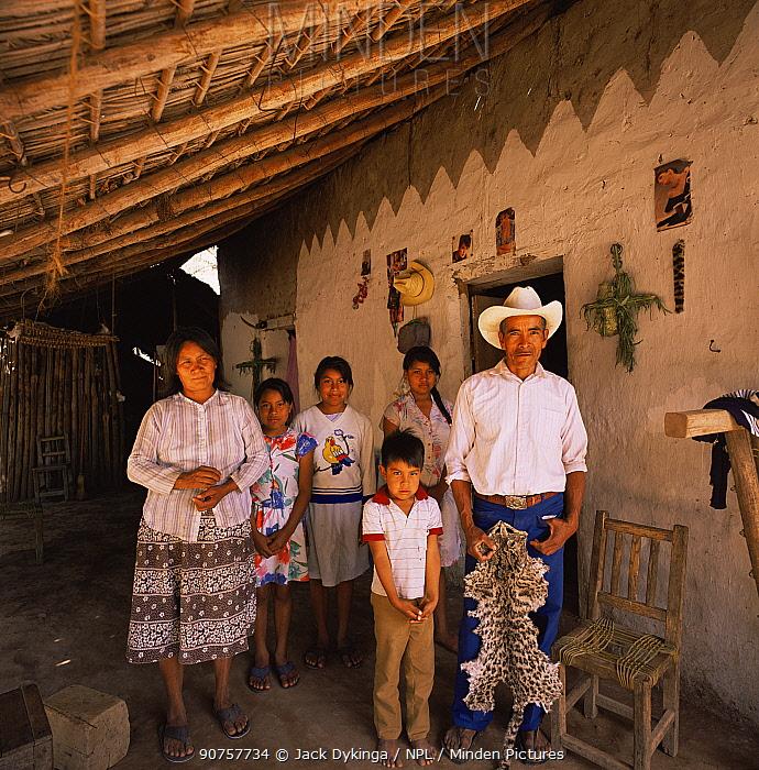 Family with Ocelot pelt, nr Rio Cuchujaqui, Sierra Madre, Mexico