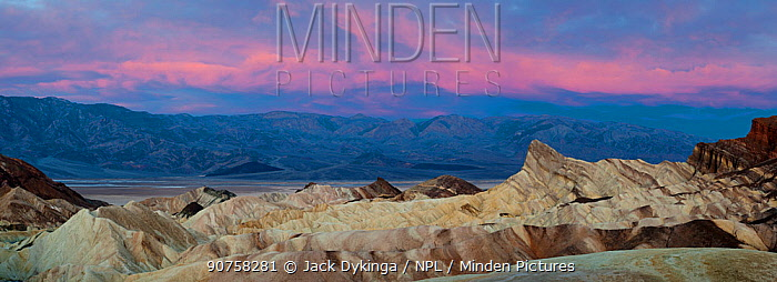 Zabriskie Point at dawn with the Panamint Mountains in background, Death Valley National Park, Mojave Desert, California, USA