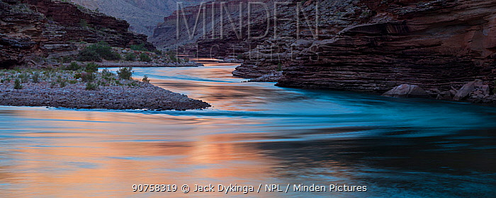 The sunrise glow on the Colorado River in the Grand Canyon at a stretch of river know as Conquistador Aisle. Grand Canyon National Park, Arizona. May 2012.