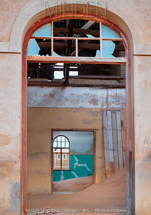 Abandoned homes in the diamond mining ghost town. Kolmanskop, near the Skeleton Coast, Namibia. June 2013.