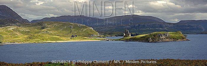 Calda House and the 16th century Ardvreck Castle ruins at Loch Assynt in the Highlands at sunset, Sutherland, Scotland, UK, September 2016