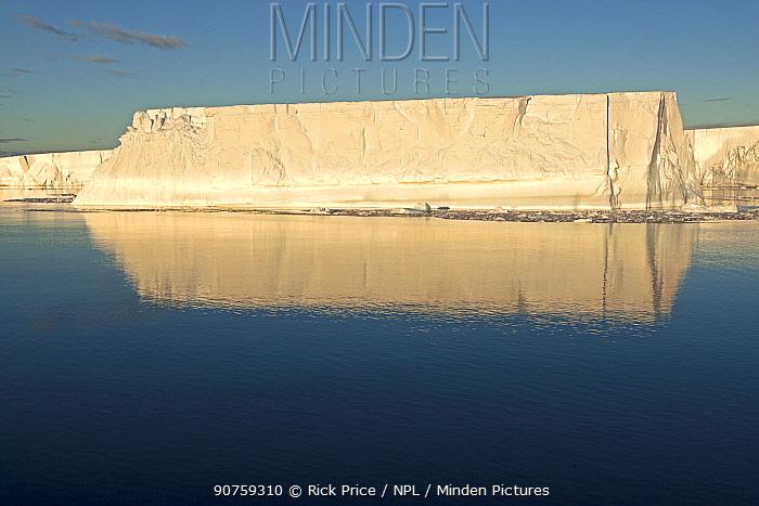 Tabular iceberg on a calm sea, Antarctic Peninsula, Antarctic Sound, Antarctica. December 2015.