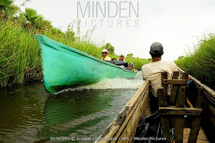 Man in canoe Rio Platano Biosphere Reserve and UNESCO World Heritage Site, La Mosquitia, Honduras