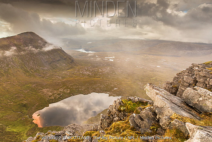 Lochan Bealach Cornaidh and Quinag ridge from Spidean Coinich in stormy weather, Assynt, Sutherland, Scotland, September