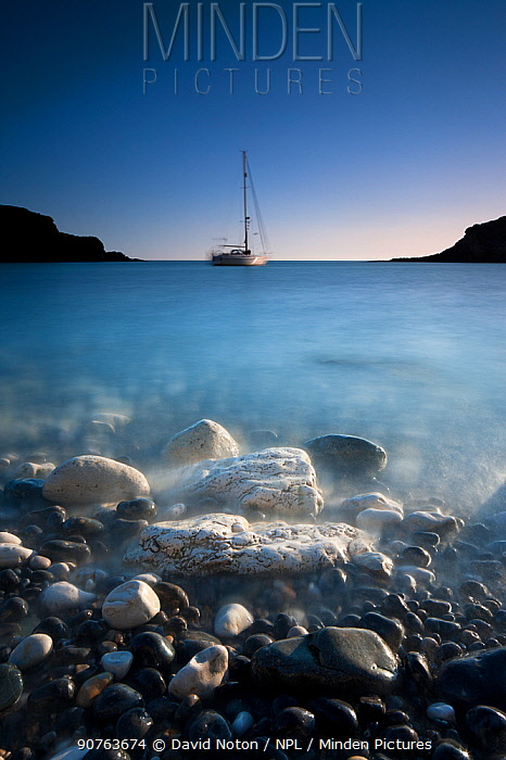 Low level view, long exposure of Lulworth Cove at dusk, Jurassic Coast, Dorset, England, UK. March 2012.