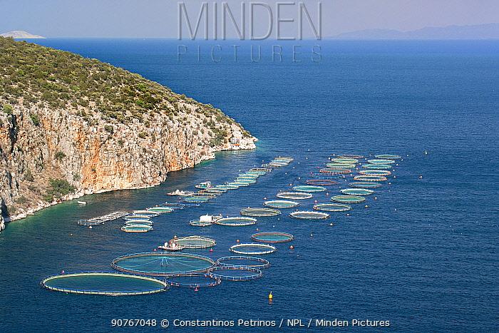 Fish farming sea cages at Selonda Bay / Korfos Bay, Aegean Sea,  Peloponnese, Greece. August 2007