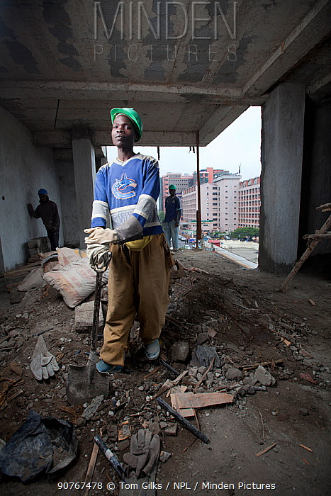 Economic migrants from rural areas working on construction site, Nairobi, Kenya, November 2013.
