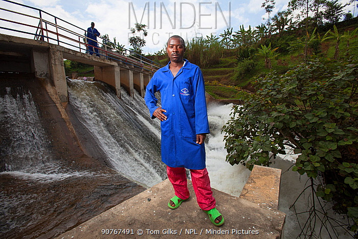 Technicians standing in front of hydro electric power plant, Rwanda, September 2014.