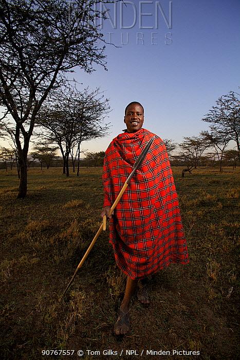 Maasai man with spear, Mara region, Kenya, September 2013.