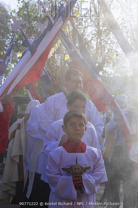 Priest and choir boys participating in Cuasimodo, a Catholic festival, Colina, Chacabuco Province, Santiago Metropolitan Region, Chile, Latin America. April 2017.