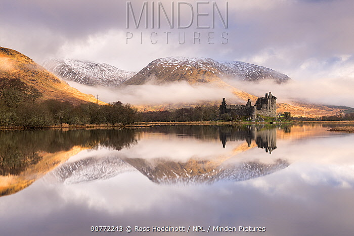 Kilchurn Castle, sunrise, early morning mist and light, a ruin on a rocky peninsula, the northeastern end of Loch Awe, in Argyll and Bute, Scotland, UK. March 2017.