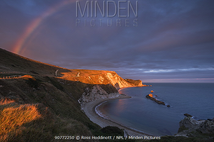 Rainbow over Man O'War Bay, near Lulworth, Dorset, UK. September 2016.