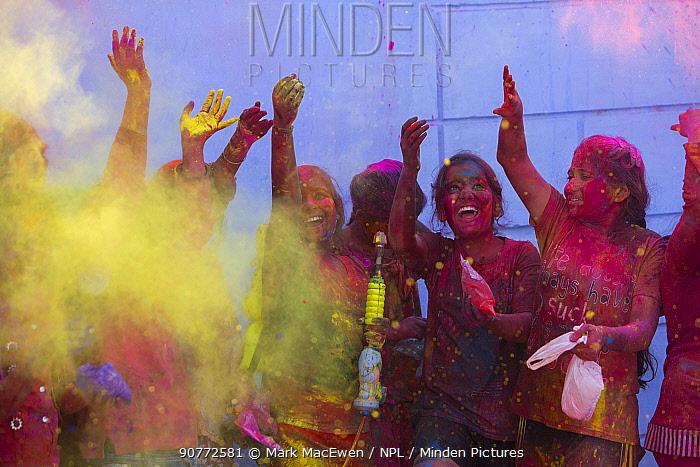 Children throwing coloured powder during Holi festival,  Jodhpur, Rajasthan, India. March 2015
