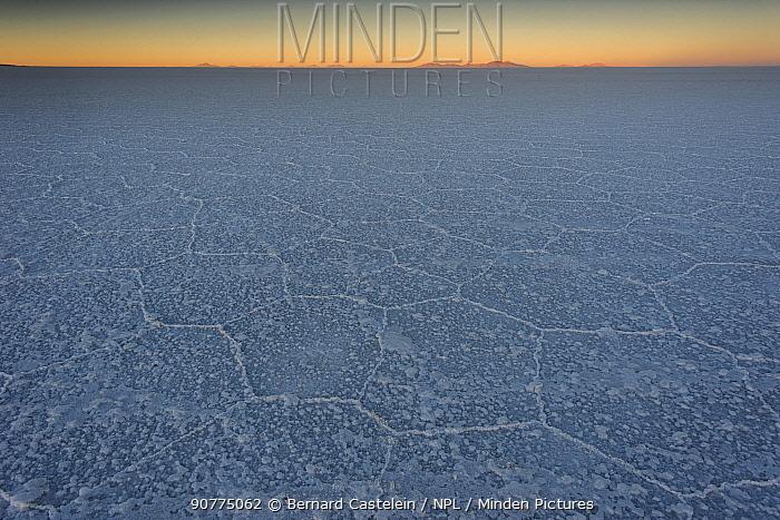 Salt pan, Salar de Uyuni at sunrise, Altiplano, Bolivia, April.