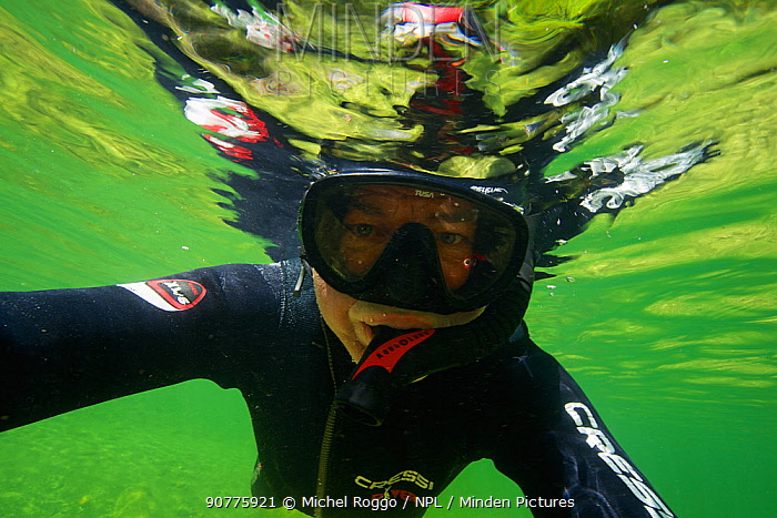 Photographer Michel Roggo  snorkelling in the Sense river, Cantons of Fribourg and Bern, Switzerland. July.  Photographed for The Freshwater Project.