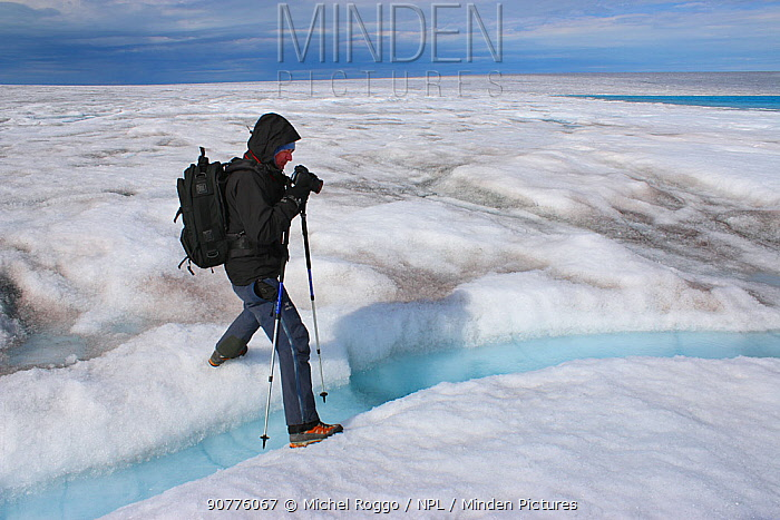 Photographer Michel Roggo at work on the ice cap above the Sermeq Kujalleq Glacier, close to the Kangia River, Ilulissat Icefjord UNESCO World Heritage Site, Sermersuaq / Greenland ice sheet, Greenland, August 2014. Working on The Freshwater Project