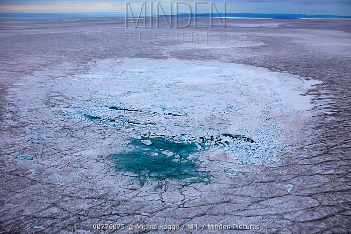 Aerial view of meltwater lake with collapsed ice cover on ice cap north-east of Sermeq Kujalleq Glacier, Ilulissat Icefjord UNESCO World Heritage Site, Sermersuaq / Greenland ice sheet, Greenland, August 2014. Photographed for the Freshwater Project.