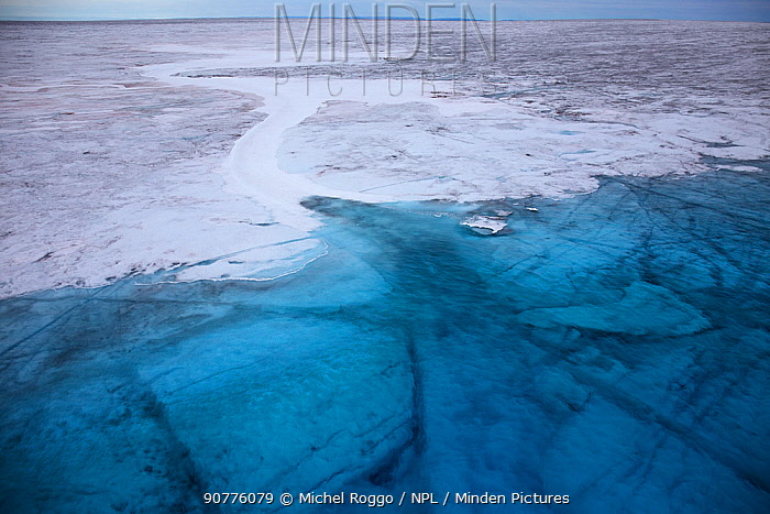 Aerial shot of Meltwater lake on the ice cap north-east of Sermeq Kujalleq Glacier, Ilulissat Icefjord UNESCO World Heritage Site, Sermersuaq / Greenland ice sheet, Greenland. August 2014. Photographed for the Freshwater Project.