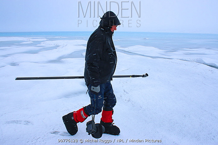 Photographer Michel Roggo at work on ice cap above the Sermeq Kujalleq Glacier, close to the close to the Kangia River, Ilulissat Icefjord UNESCO World Heritage Site, Sermersuaq / Greenland ice sheet, Greenland, August 2014. Working on The Freshwater Project