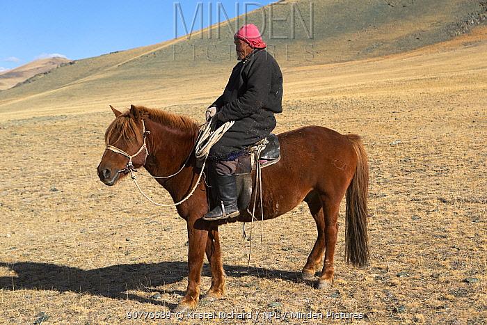 Tuva Hersdman on his Mongolian horse, Tsengel Khairkhan, near the border with China and Kazakhstan, Bayan-Olgiy aymag, Mongolia. September.