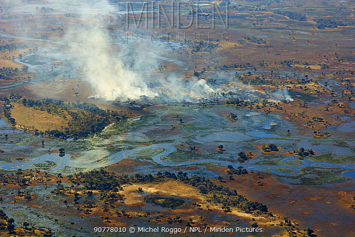 Aerial view of the Okavango Delta, with high water and bush fire, Okavango Delta, Botswana,  June 25, 2014 . Photographed for The Freshwater Project