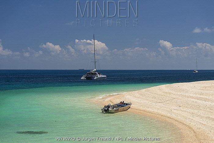 Nudey Beach with catamaran and motor boat, Fitzroy Island, Tropical Far North Queensland, Australia. November 2015.
