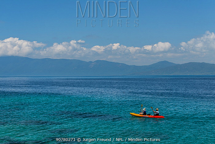 Tourists kayaking around Nudey Beach, Fitzroy Island, Tropical Far North Queensland, Fitzroy Island, Tropical Far North Queensland, Australia. November 2015.