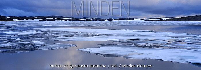 Lake in tundra landscape, Nordkinn Peninsula, Norway, June.