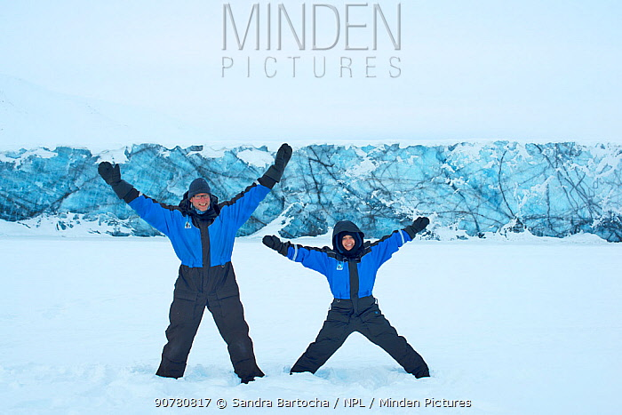 Photographer Sandra Bartocha with Werner Bollmann in the snow. Svalbard, Norway, March 2014.