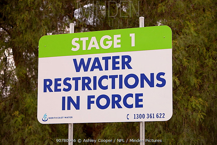 Signs near Echuca, Australia, about water restrictions and saving water. Victoria and New South Wales were affected by a drought which lasted from 1996-2011. Victoria, Australia, February 2010.