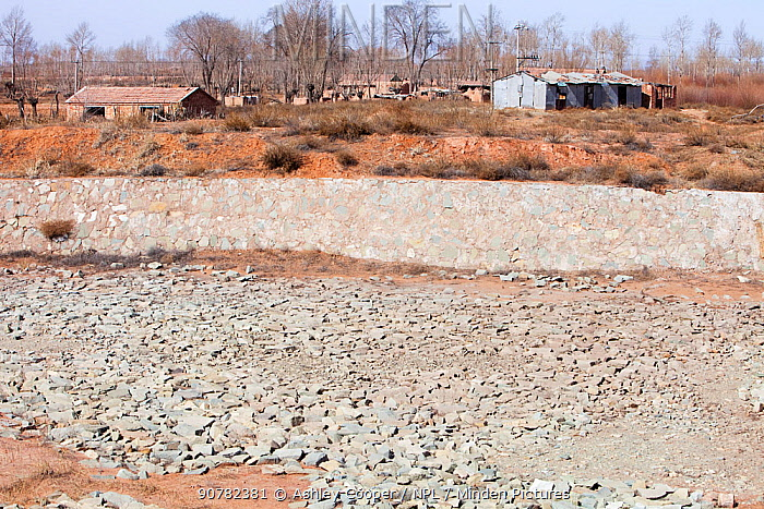 Village water storage reservoir which has completely dried up during drought. Shanxi province, China. March 2009.