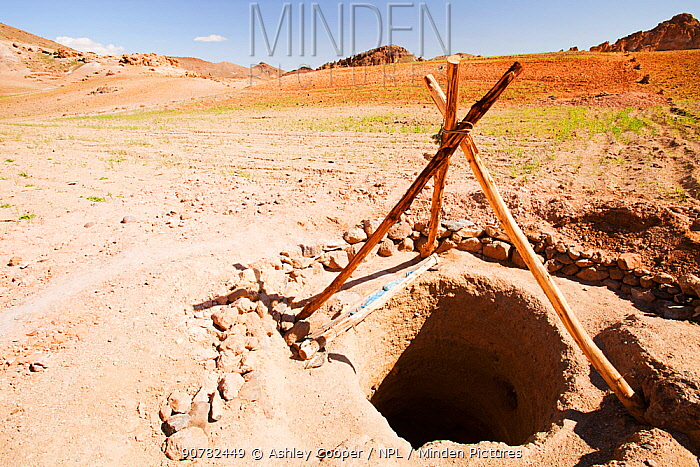 Well in the Anti Atlas mountains of Morocco, North Africa. In recent years, rainfall totals have reduced by around 75% as a result of climate change. This has led to many Berber villagers abandoning their fields and migrating to the cities to try and find work, as they can no longer grow food to support themselves.