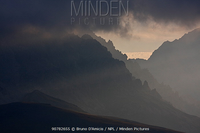 Light filtering through clouds on rugged southern slope of Mount Prena in the Gran Sasso massif. Gran Sasso NP, Central Apennines, Abruzzo, Italy, September.