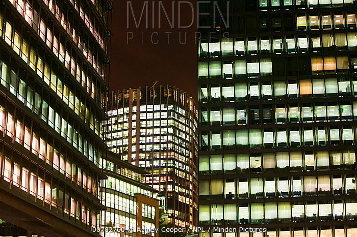 Office blocks burning energy with lights on at night,  in London, England, UK. September 2005.