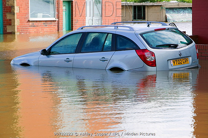 Car in flood waters in the village of Toll Bar near Doncaster, South Yorkshire, England, UK, 28th July 2007.
