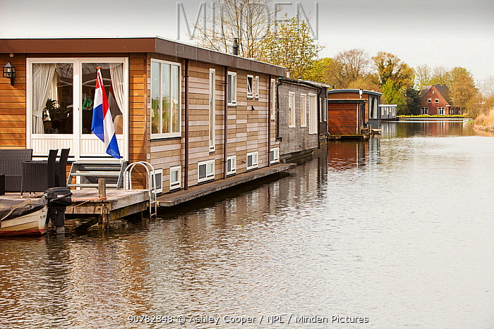Floating houses on  canal near Amsterdam, Netherlands. April 2013.