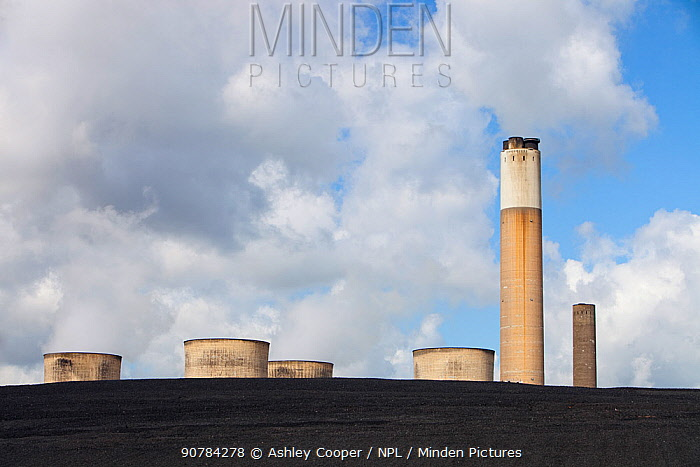 Ratcliffe on Soar coal fired power station near Nottingham, UK, showing the cooling towers and chimney rearing up from a mountain of coal